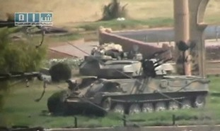 Tank sits in Hama, Syria