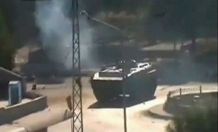 Syrian tank moves through city (illustrative)