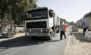 Trucks enter the Gaza Stri