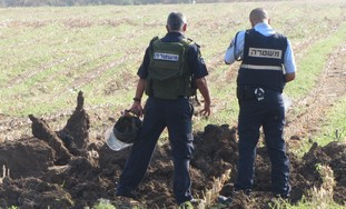 Police survey site of Grad rocket explosio