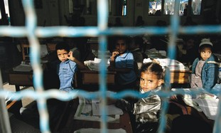 Palestinian pupils attend an UNRWA school in Gaza.