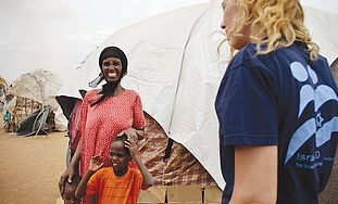 AN ISRAELI aid worker speaks to a Somalian woman i
