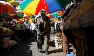 Palestinian man walks through the market