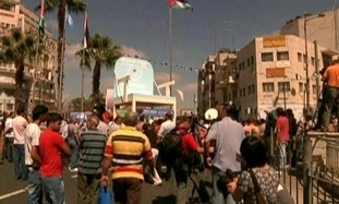Palestinians march in Ramallah.