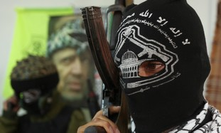 Masked member of Fatah military wing [file]