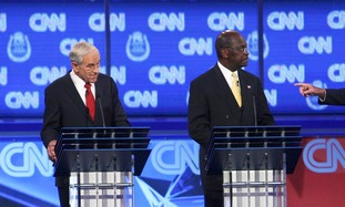 Republican candidates Ron Paul and Herman Cain