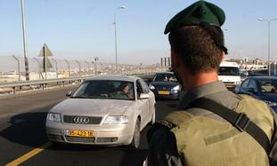 IDF soldier at roadblock.