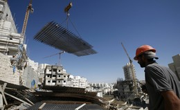 Palestinians work on a construction site