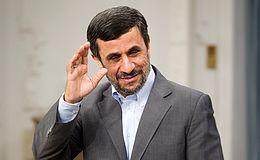 Iranian President Mahmoud Ahmadinejad waves to med