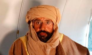 Saif al-Islam Gaddafi is seen sitting in a plane