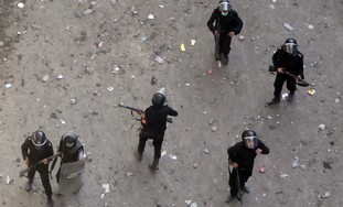 Egyptian police stand guard in Tahrir Square