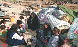 Beduins after eviction from shantytown near Ma'ale