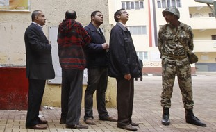 Egyptians, soldier at the polls