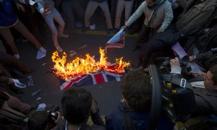 Protesters burn UK flag removed from Iran embassy