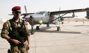 Iraqi soldier guards fighter plane