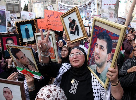 Palestinian woman protesting in Ramllah