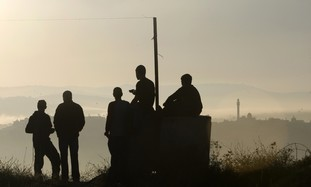Settlers gather for prayer in Ramat Gilad