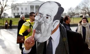 Protester wearing mask of Iraqi PM al-Maliki.