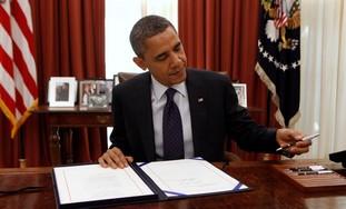 Barack Obama signing a bill [file photo]