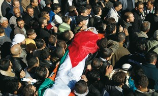 PALESTINIANS CARRY the body of Mustafa Tamimi