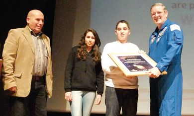 William McArthur Jr. receives gift from students,