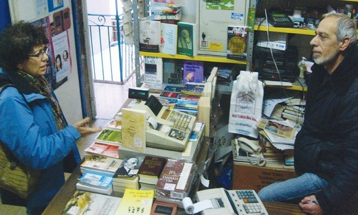 Uri Rucham serves a customer