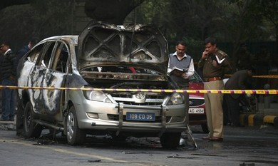 India police inspect car after embassy attack