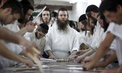 Orthodox men prepare matza