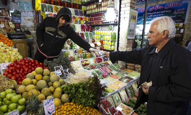 Iranian man shops in a bazar in Tehran