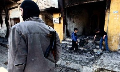 Syria opposition guard, boys clean bombed-out shop