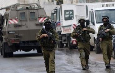IDF soldiers patrol during a raid [file]