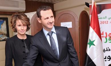 Asma Assad and Bashar Assad vote.