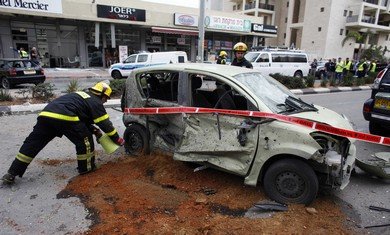 Israeli car damaged from Gaza rocket