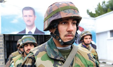 Syrian soldiers attend funeral for their comrade.