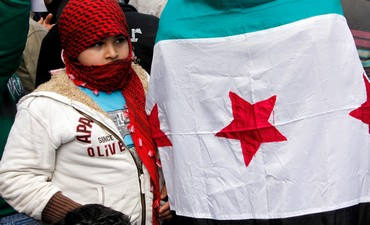 Child near Syria opposition flag