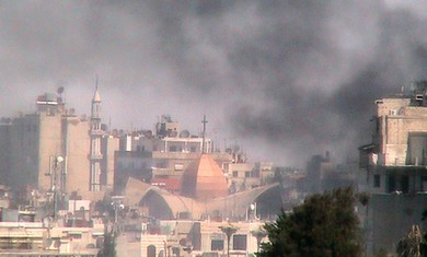 Smoke rises from Bab Sabaa neighborhood of Homs