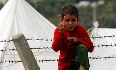 Syrian refugee boy on Turkish border