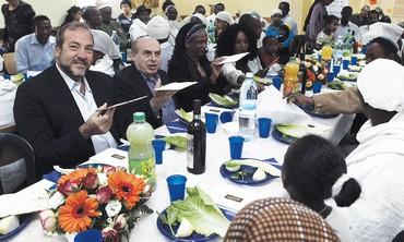 Sharansky with Ethiopian olim in mock seder