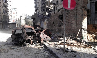 Buildings damaged by Syrian govt shelling in Homs