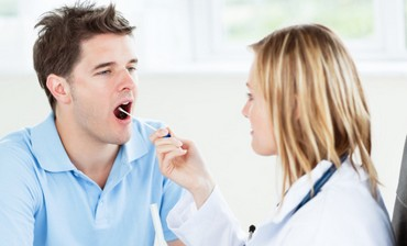 nurse checks a mouth