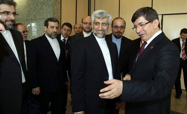 Iranian nuclear negotiator Jalili with Davutoglu