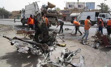 Cleaning up after bombs explode in Iraq.