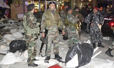 Lebanese soldiers at bombed Tyre restaurant