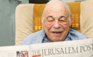 Marlin Levin reads 'The Jerusalem Post'