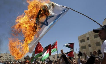 Jordanian protesters burn Israeli flag [file]