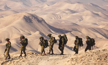 IDF soldiers march in the Judean Desert