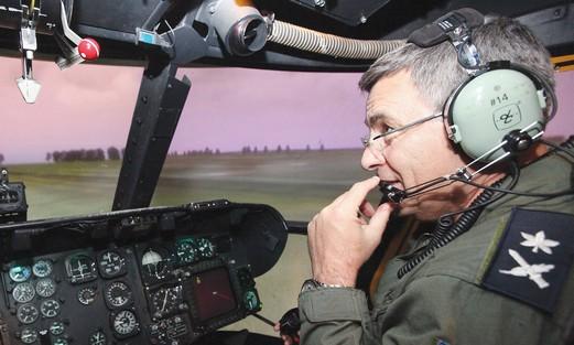 Nehushtan in cockpit of Cobra attack helicopter
