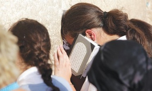 Women pray at the Western Wall.
