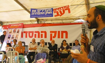 Activist Yehudah Yifrach at Ulpana protest tent