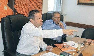 Avner Kopel (left) announces resignation